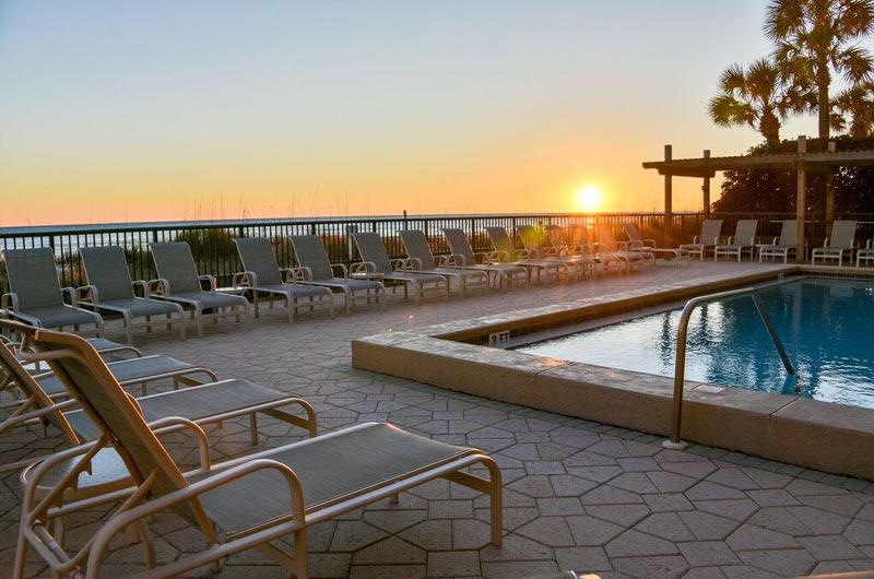 View of pool at sunset at Destin Beach Club in Destin FL