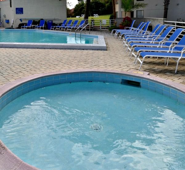 Hot tub by the pool at TOPS'L Summit   in Destin Florida