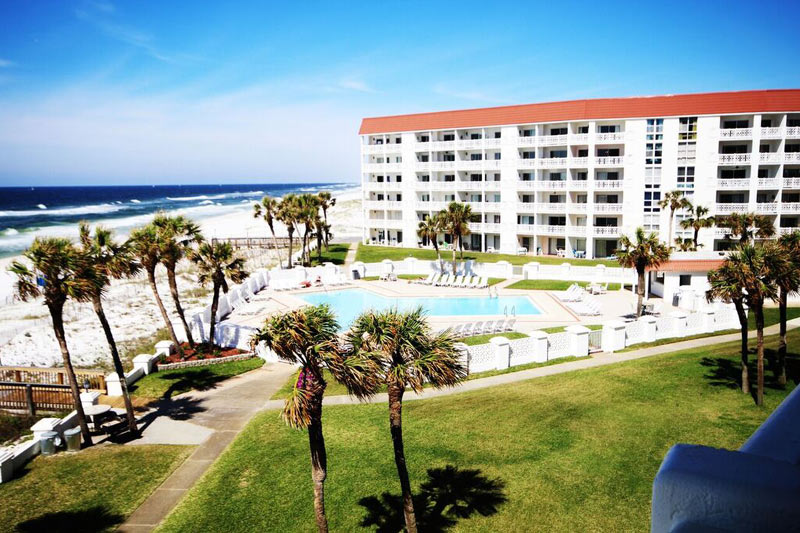 Aerial view of landscaped grounds and Gulf-front pool at El Matador Fort Walton Beach