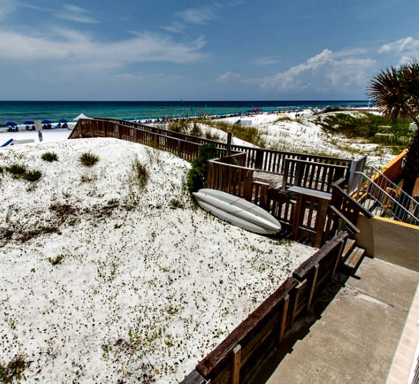 A boardwalk across the dunes offers easy beach access at Gulfside Condo Fort Walton Beach.