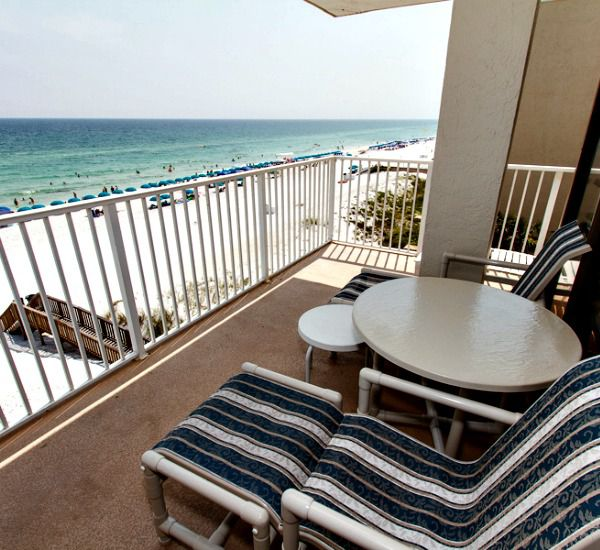 Tables and chairs furnish a Gulf-front balcony at Gulfside Condo Fort Walton Beach.