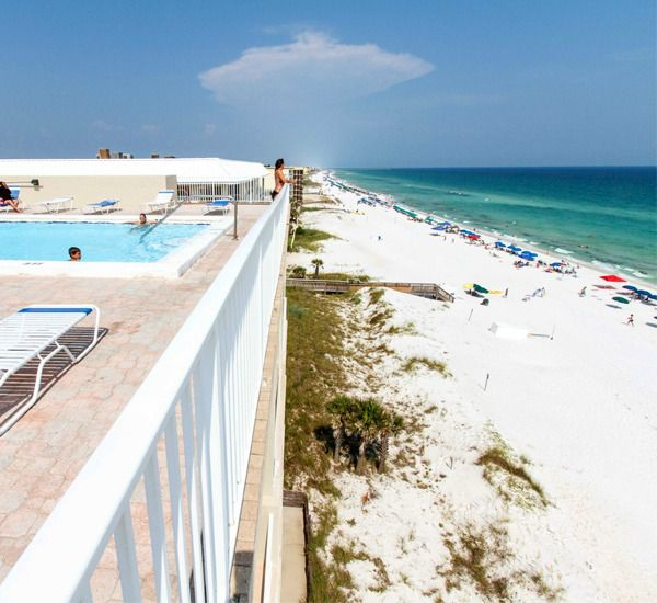 Gulf-front pool and sundeck overlooking the beach at Gulfside Condo Fort Walton Beach