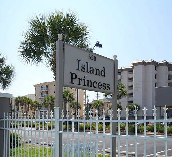 Street-side sign inside fenced grounds at Island Princess Fort Walton