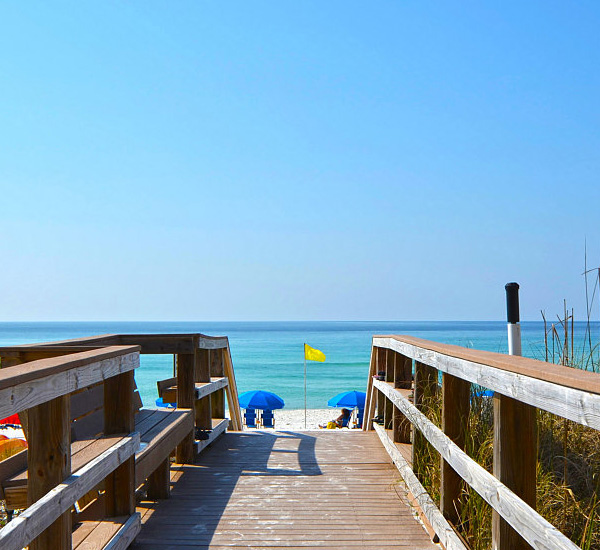 A wooden boardwalk offers easy beach access and an inviting view at Island Princess Fort Walton.