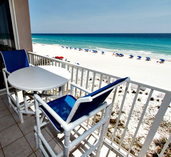 Beachfront balcony furnished with a table and pair of chairs at Island Princess Fort Walton