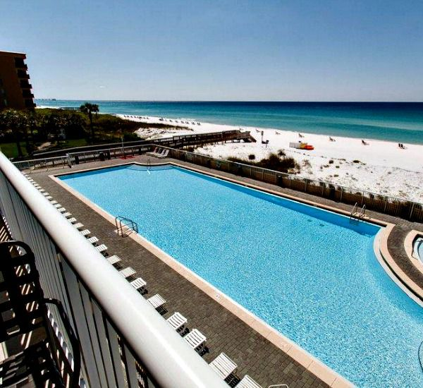 Balcony view of the pool and beach at Waters Edge Condos