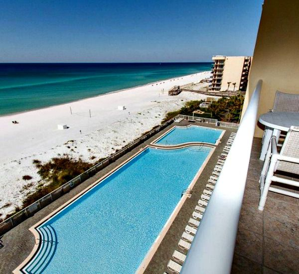 Gulf-front pool and beach at Waters Edge Condos