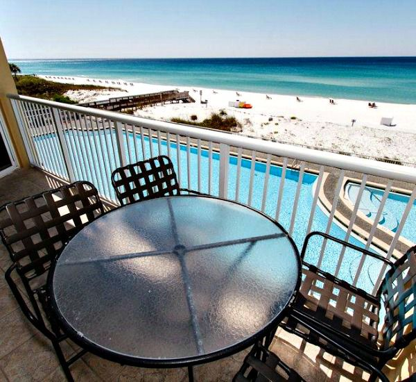 Gulf-front balcony overlooking the pool and beach at Waters Edge Condos