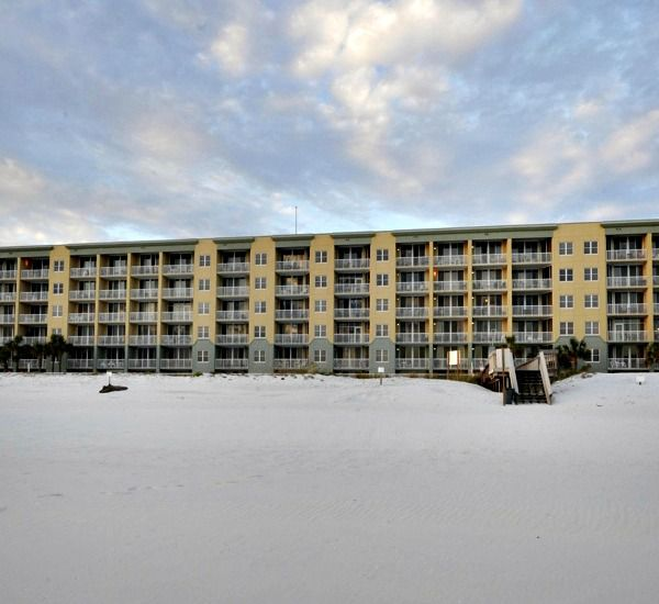 Exterior view and beach at Waters Edge Condos