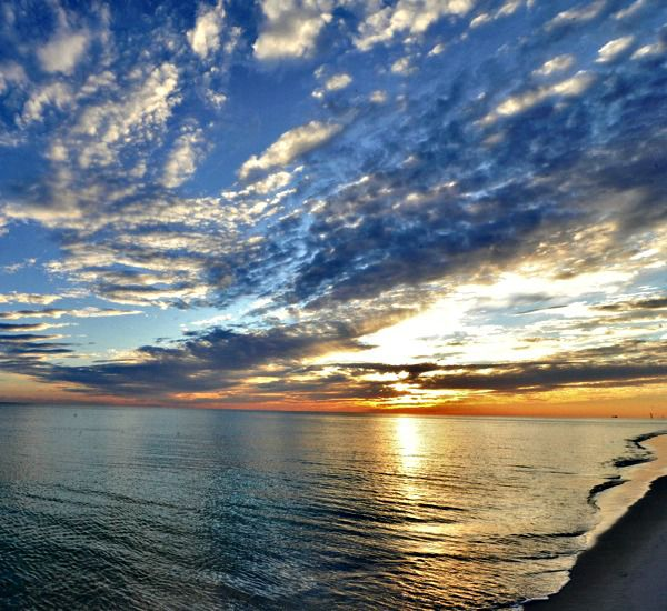 Cloudy sunset over the Gulf at Waters Edge Condos