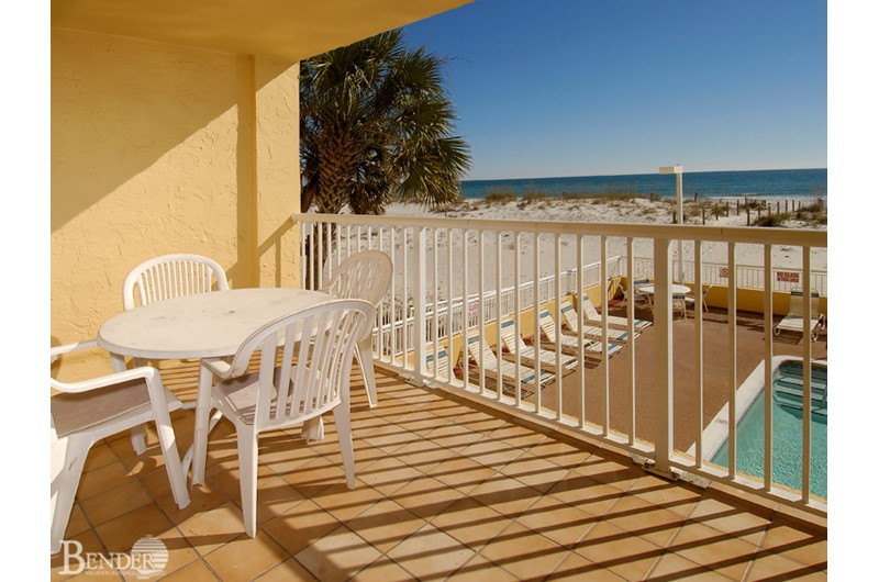 View of the pool and beach from a private balcony at Driftwood Towers Gulf Shores
