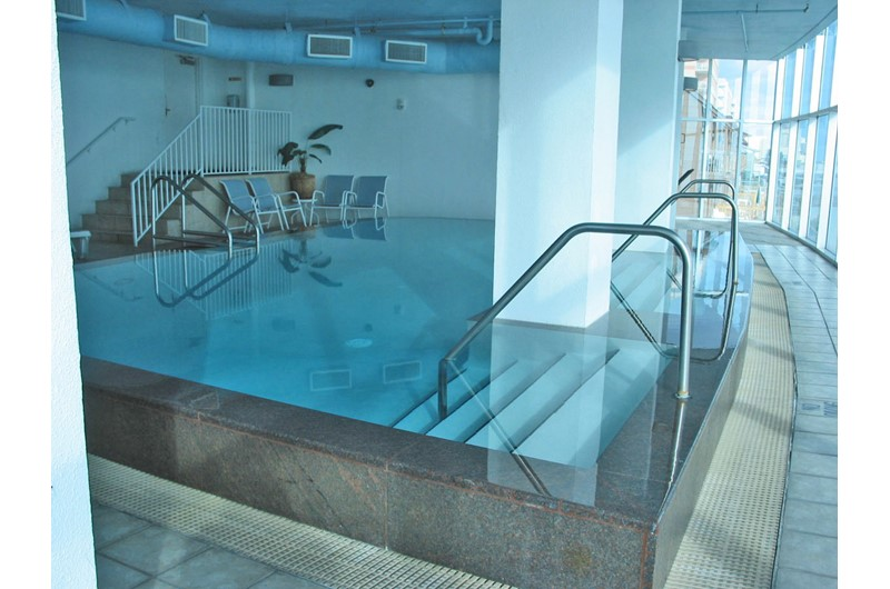 indoor pool with beach view at Island Tower Gulf Shores
