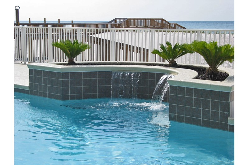 Gulf-front pool with waterfall at Legacy Gulf Shores