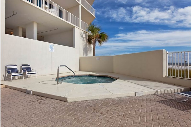 Relax and soak your cares away in the outdoor hot tub at the Lighthouse Gulf Shores.