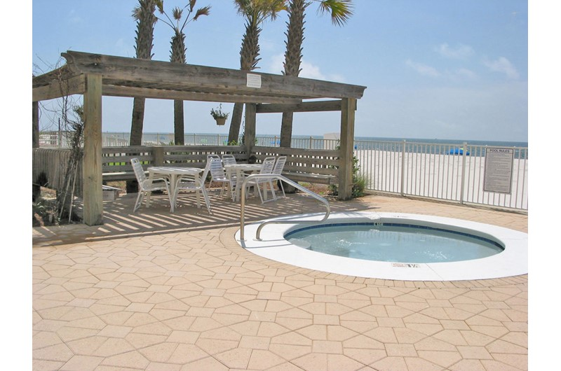 Relax and let your cares soak away in the hot tub at Ocean House Gulf Shores.