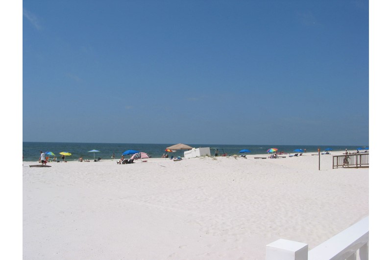 Private white-sand beach at Ocean House Gulf Shores