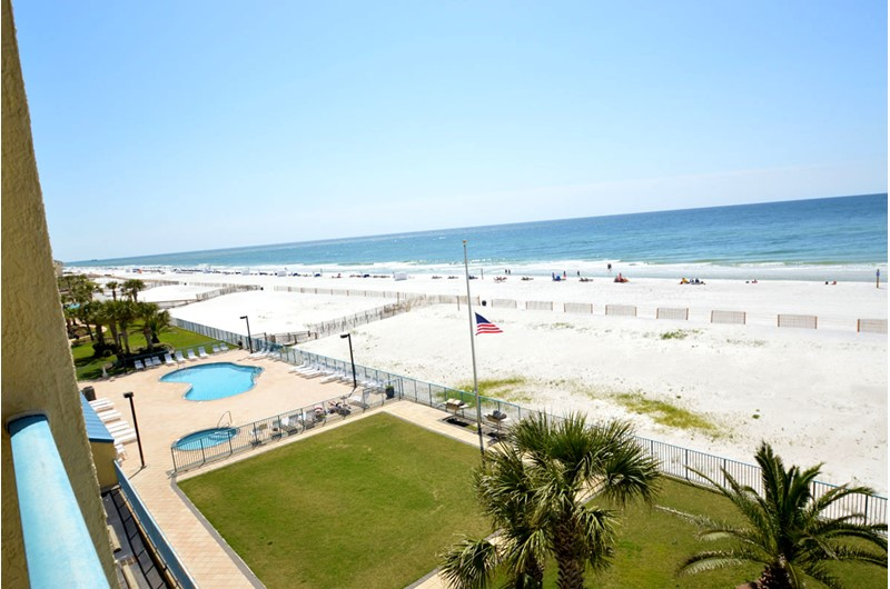 Sweeping views of the grounds beach and Gulf  at Surfside Shores Gulf Shores