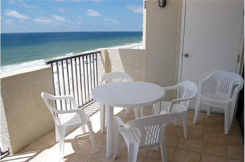 Relax on your beachfront balcony at Tropical Winds Gulf Shores AL.