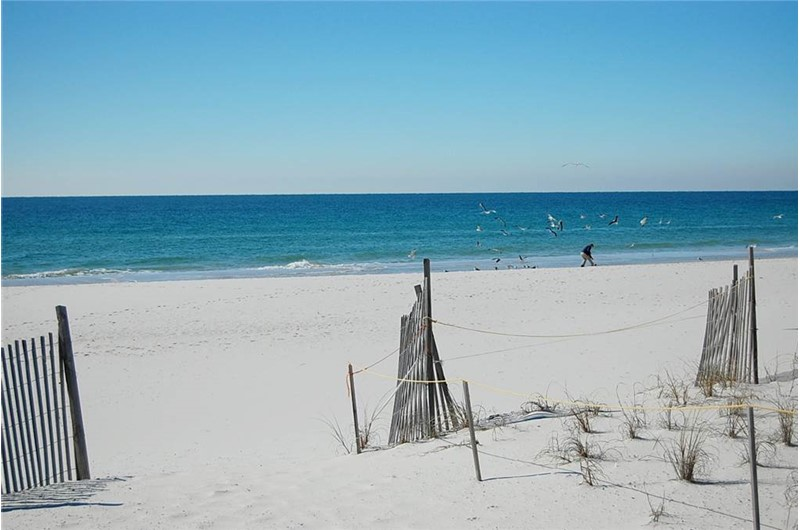 Gorgeous white sands right outside your condo at Tropical Winds Gulf Shores AL