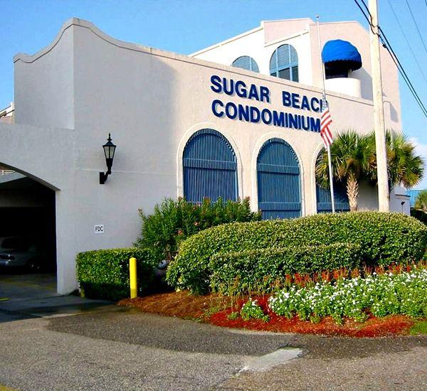 Exterior and lush landscaping at Sugar Beach Condos in Orange Beach