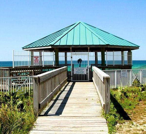 Walkover to the private beach at Amalfi Coast Resort  in Destin Florida.