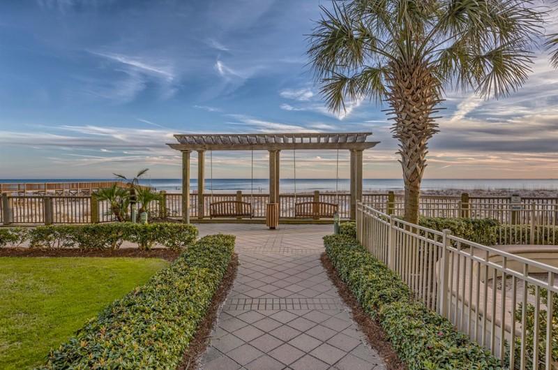 Beach Club Resort Swinging Bench in Beachfront Courtyard
