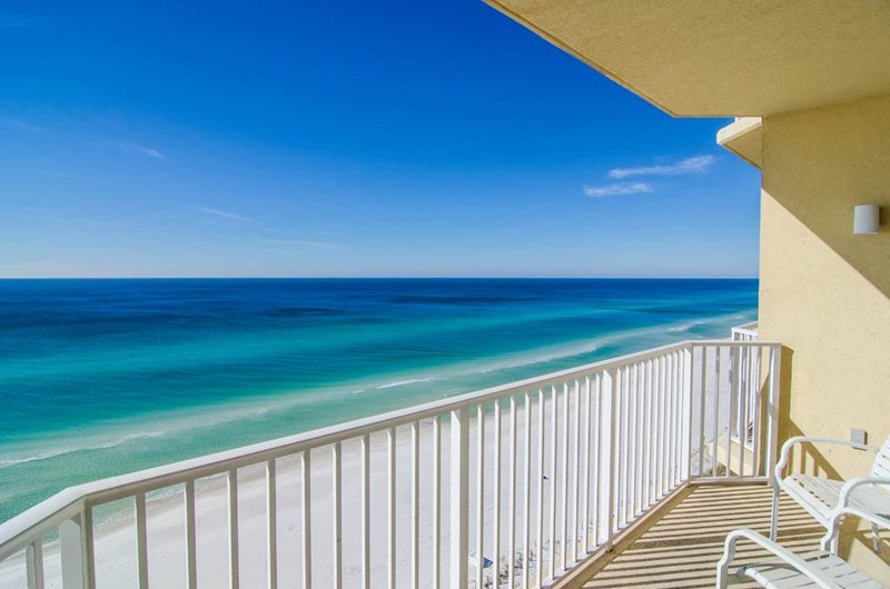 Enjoy relaxing on your balcony at Boardwalk Beach Resort Condos in Panama City Beach FL