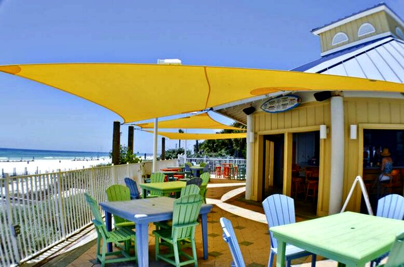 Outdoor seating at the Boardwalk Beach Resort beachfront bar in Panama City