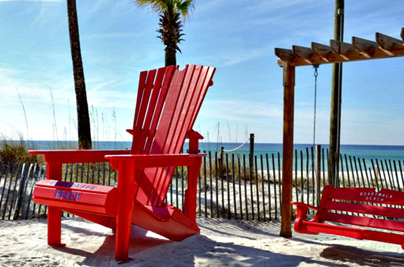 Bright red chair and swing on the beach at Boardwalk Beach Resort Hotel in Panama City