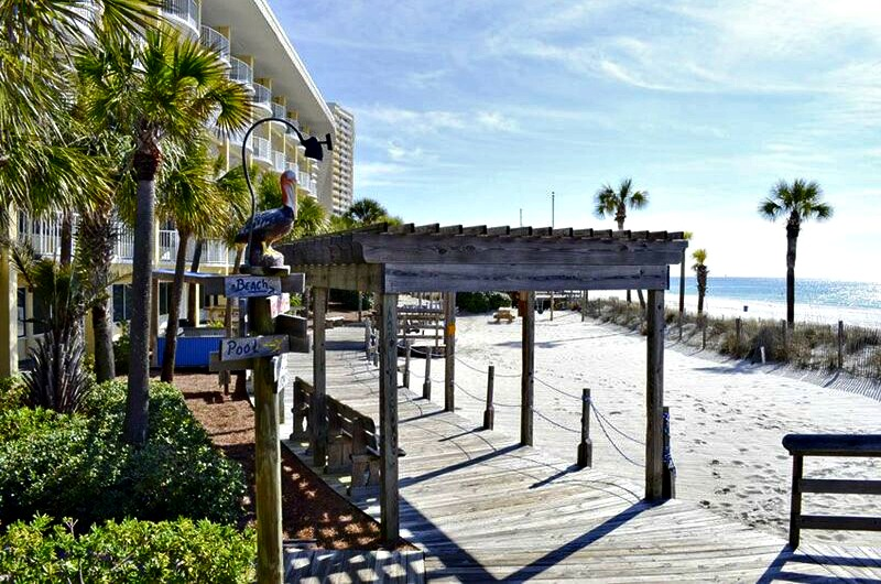 Beachfront walkway and pelican sign at Boardwalk Beach Resort Hotel in Panama City