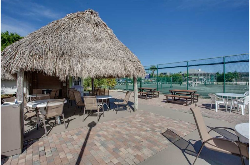 Eating area with tennis court view at Bonita Beach & Tennis in Bonita Springs FL