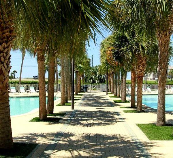 Walkway separating the two pools at Amalfi Coast Resort in Destin Florida.