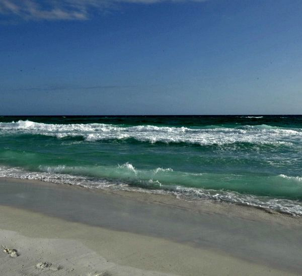 The beach at the Beach House Resort Condominiums in Destin Florida.
