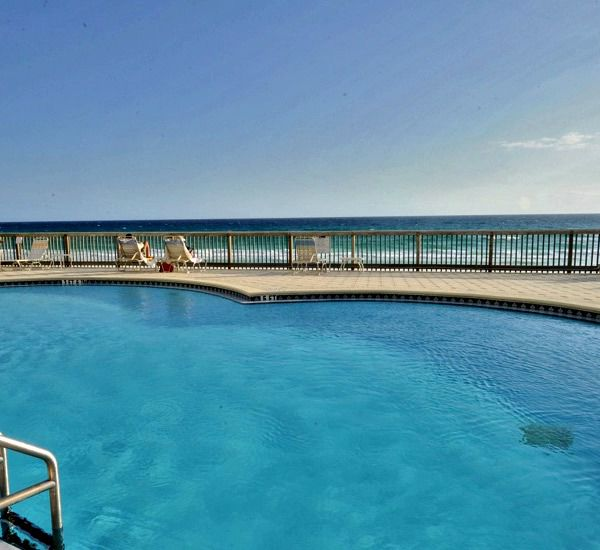 The pool overlooking the beach  at the Beach House Resort Condominiums in Destin Florida.