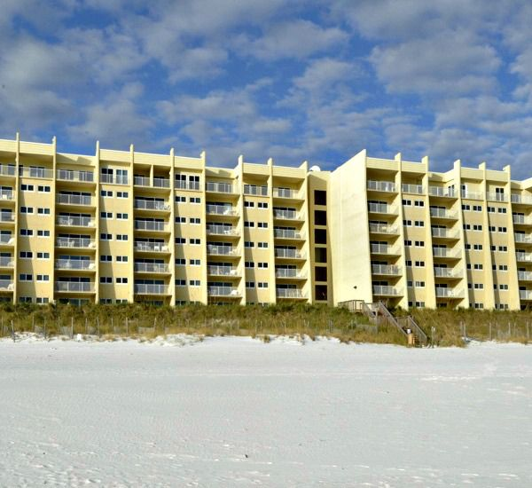 Beach view of the Beach House Resort Condominiums in Destin Florida.