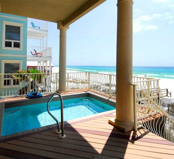 You can opt for sun or shade when swimming in this private pool on the premises of one of the properties available through Destin Beach House Rentals