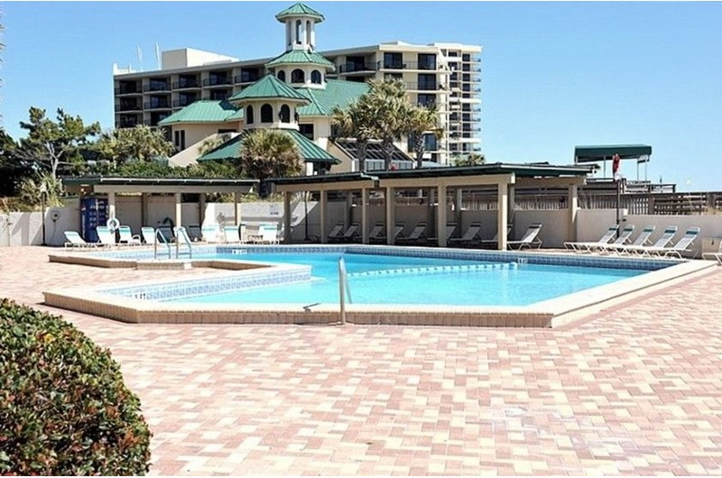 Take a dip in the large pool at Beachside Towers in Destin FL