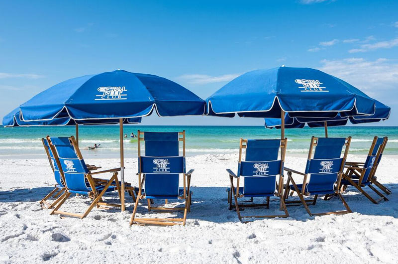 Beach chairs and umbrella at Coral Reef Club in Destin FL
