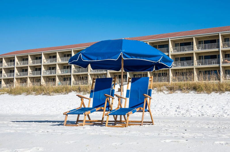 Beach chairs and umbrella at Destin Seafarer in Destin FL