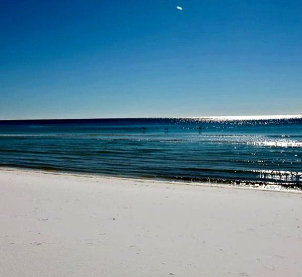 The beach at Emerald Towers  in Destin Florida
