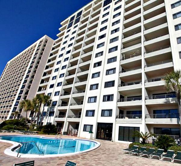 Exterior view of the building with the pool at Emerald Towers  in Destin Florida