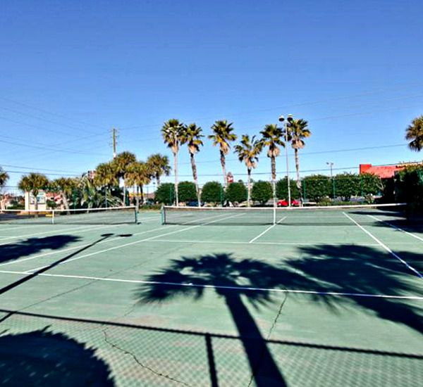 Two tennis courts at Emerald Towers in Destin Florida.