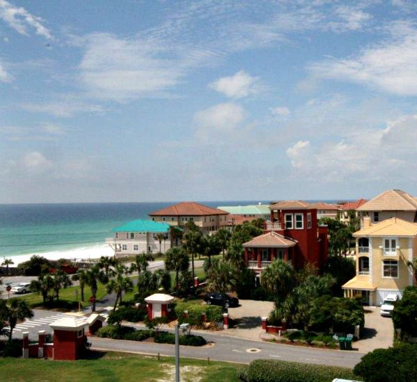 View of the property with the Gulf beyond at Enclave Destin FL