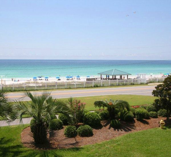 View of landscaped grounds and private beach (across the street) at Gulf Winds East Destin FL
