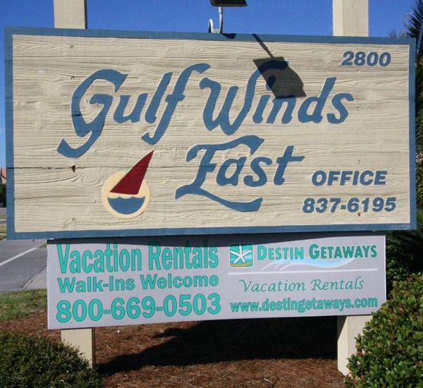 Closeup view of the marquee at the entrance of Gulf Winds East Destin FL