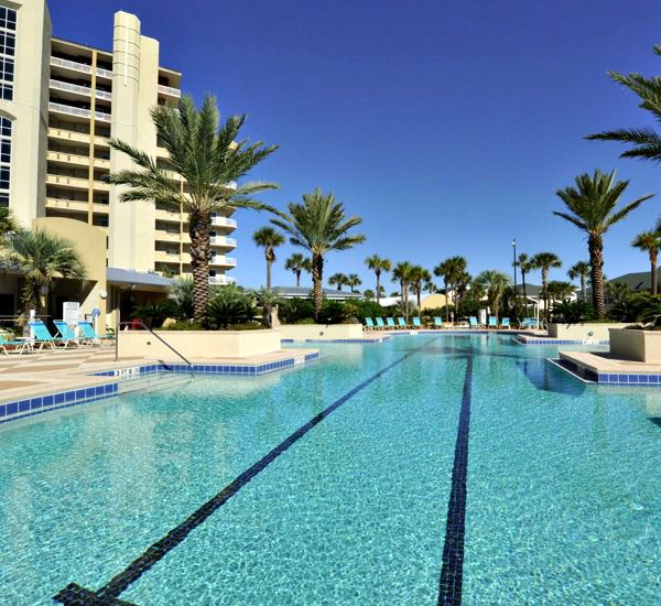 The entire family will fit around the pool at Harbor Landing  in Destin Florida