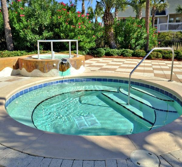 Relax in the oversized hot tub at Harbor Landing  in Destin Florida