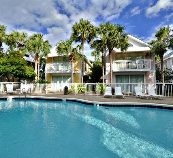 Colorful cottages surround the heated pool at Nantucket Rainbow Cottages   in Destin Florida