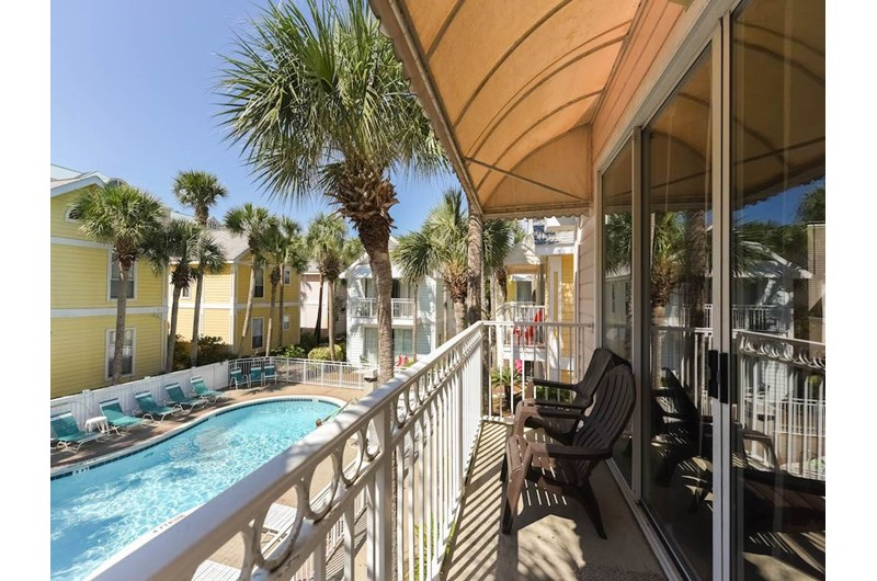 Relax on the balcony overlooking the pool at Nantucket Rainbow Cottages in Destin Florida