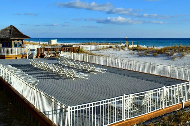 Beachfront sunning deck at Pelican Beach Resort in Destin FL